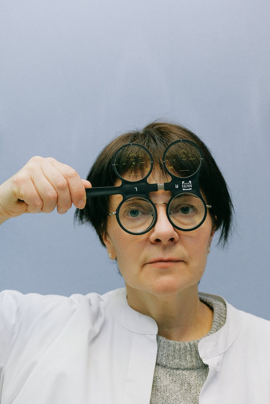 female doctor using ophthalmic magnifier with four lenses